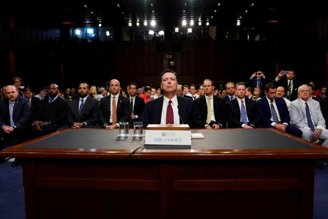 Former FBI Director Comey testifies before a Senate Intelligence Committee hearing in Washington