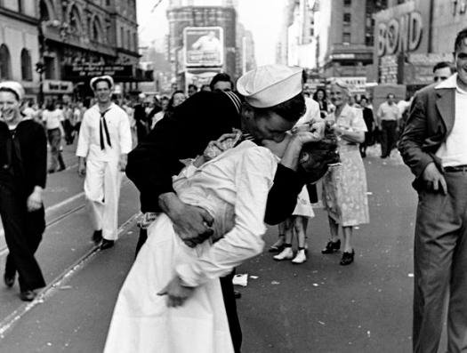 Happy sailor kissing nurse in Times Square during impromptu VJ Day celebration following announcement of the Japanese surrender and the end of WWII.